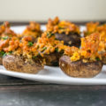 These Dairy-Free Sausage Stuffed Mushrooms are the perfect appetizer with their spicy, meaty filling. Serve this to your guests and this will be the recipe everyone will ask you about!