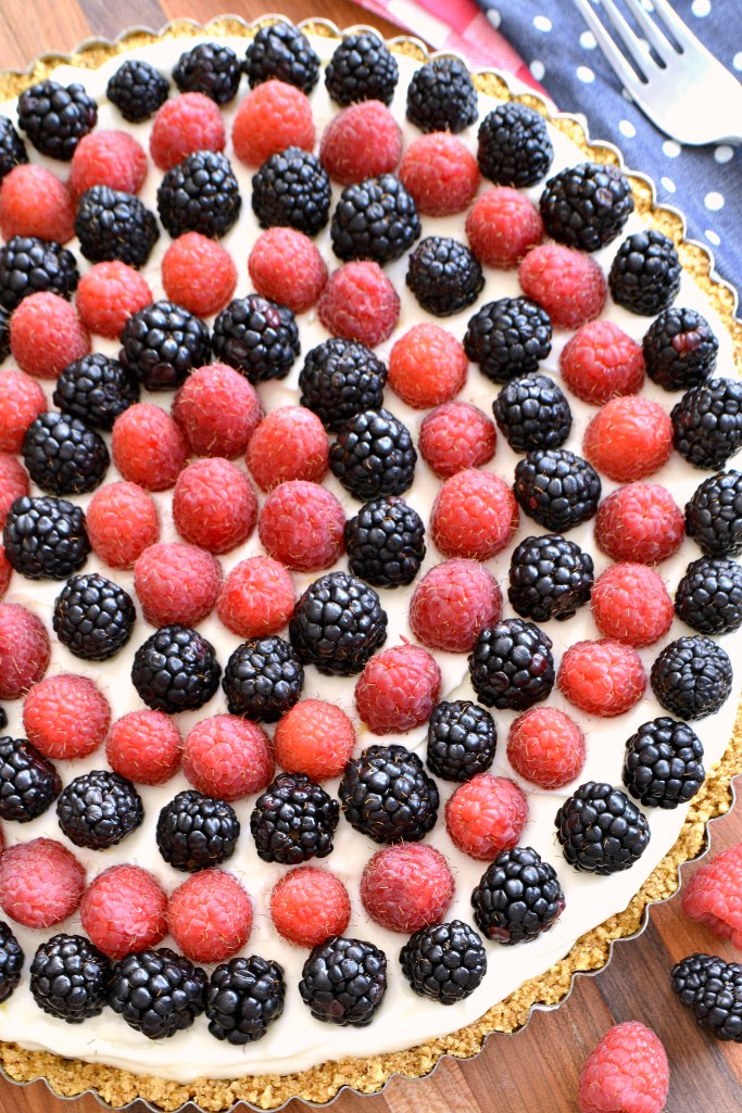 Celebrate your favorite patriotic holiday with this delicious Red, White, and Blue Cheesecake Tart. It's an easy, yet decadent, no-bake recipe that your whole family will love!