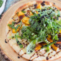 Fire up the grill and grab your best summer produce for this tasty GF Balsamic Glazed Grilled Peach Pizza recipe! Not only are we grilling the pizza, but the peaches too. Top it all off with spicy arugula and sweet balsamic glaze for the perfect gluten-free pizza!