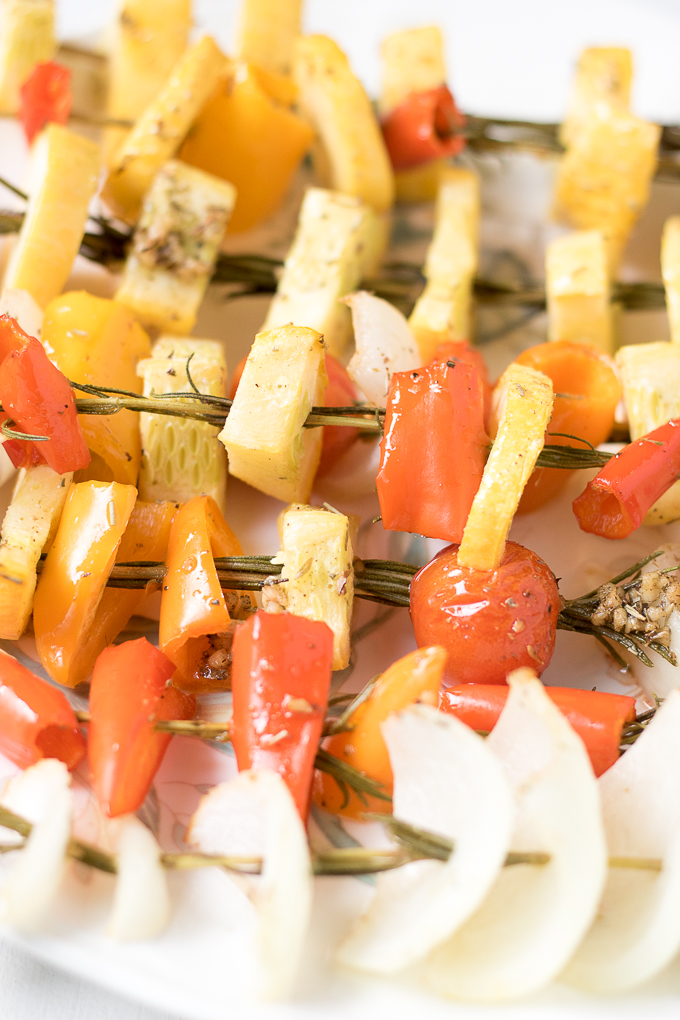 These delicious Baked Rosemary Vegetable Skewers made with garden fresh summer vegetables are the perfect way for you to enjoy seasonal produce. You can bring them to any summer gathering or enjoy them as a unique way to serve vegetables at dinner.
