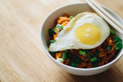Dream of foreign lands and satisfy those South Korean cravings when you learn how to make this mouth-watering Kimchi Fried Rice at home. Indulgent and economical, you need this dish in your life!